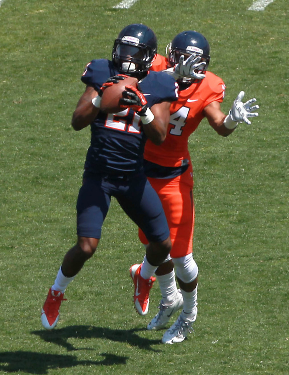 Virginia safety Brandon Phelps (21) makes an interception in front of Virginia wide receiver Andre Levrone (14) during the annual Virginia football Orange-Blue Spring Game Saturday at Scott Stadium in Charlottesville, VA. Photo/The Daily Progress/Andrew Shurtleff