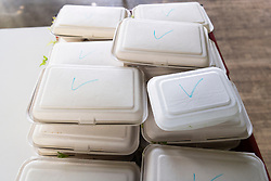 © Licensed to London News Pictures. 24/04/2020. London, UK. Shown is prepared takeaway food by staff and volunteers from Refettorio Felix for the vulnerable at St Cuthbert's Centre in Earls Court. The organisation now provides more than 500 meals a day seeing a ten-fold increase since the Covid 19 outbreak. It also provides meals to refugees, children of NHS staff and to the venerable with mental health issues. Editorial usage only. Photo credit: Ray Tang/LNP