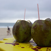 Coconuts are available in abundance and are a popular refreshing natural drink sold along the beaches of Rio de Janeiro throughout the year. Copacabana Beach, Rio de Janeiro,  Brazil. 16th July 2010. Photo Tim Clayton
