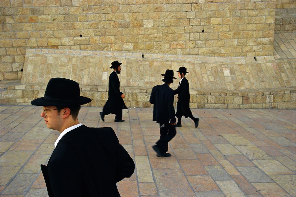 Jerusalem, Israel:  Religious Jews make a final visit to the Western Wall before sundown on Shabbat, or the Sabbath.