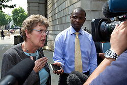 © Licensed to London News Pictures. 05/07/2013. London, UK. Jane Deighton (L), solicitor for Duwayne Brooks (R), friend of murder victim Stephen Lawrence, talks to media on Whitehall in London today (05/07/2013) after meeting with British Deputy Prime Minister Nick Clegg, over allegations that the Metropolitan Police Service bugged meetings between themselves, Brooks and his lawyers in an effort to smear the Lawrence family and their friends. Photo credit: Matt Cetti-Roberts/LNP