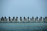 Royal Navy sailors line the deck of the frigate HMS Monmouth F235, on 23rd August 2001, near Portsmouth, England.