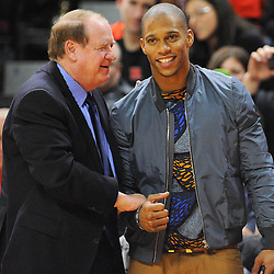 Former New Jersey governor Richard Codey shakes hands with New York Giants wide receiver Victor Cruz during first half Big East NCAA Basketball between the Rutgers Scarlet Knights and Seton Hall Pirates at the Louis Brown Athletic Center. Rutgers leads Seton Hall 28-26 at halftime.