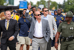 Sep 22, 2018; Morgantown, WV, USA; West Virginia Mountaineers head coach Dana Holgorsen waves to fans as he arrives to the stadium to play Kansas State Wildcats at Mountaineer Field at Milan Puskar Stadium. Mandatory Credit: Ben Queen-USA TODAY Sports