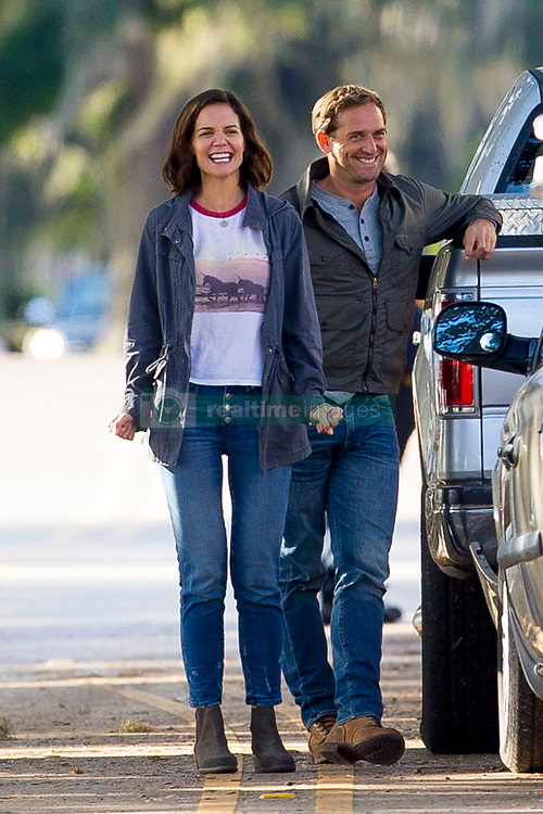 EXCLUSIVE: Katie Holmes shows her angry side as she kicks a car on the set of her new movie while wearing a unicorn t-shirt - STILL minus the sparkling ring which sparked rumours of an engagement to Jamie Foxx. The Hollywood actress is co-starring in a feature-film adaptation of the self-help best-seller 'The Secret,' alongside Jerry O'Connell. Katie could be seen filming scenes with her other co-star Josh Lucas and the pair could be seen having quite a laugh as they filmed this 'angry' scene.. Katie sparked rumors of an engagement when she was spotted wearing a diamond ring as she walked from the production office to get a coffee. Filming did not start until the following day. But her publicist later issued a statement, insisting the ring was merely a screen prop. Holmes, who divorced 'Top Gun' star Tom Cruise in 2012, is believed to have been secretly dating Foxx for five years. Foxx is currently filming his latest movie, 'Power,' which also stars Joseph Gordon-Hewitt. Foxx, 50, and Holmes, 39, went public in April during a PDA-packed beach outing on a Malibu beach after shying away from getting cozy together in public for years. 02 Nov 2018 Pictured: Katie Holmes, Josh Lucas. Photo credit: MEGA TheMegaAgency.com +1 888 505 6342