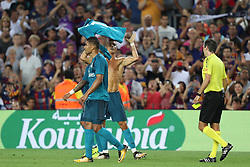 August 13, 2017 - Barcelona, Spain - Cristiano Ronaldo of Real Madrid receives a yellow card as he removes his jersey during the Spanish Super Cup football match between FC Barcelona and Real Madrid on August 13, 2017 at Camp Nou stadium in Barcelona, Spain. (Credit Image: © Manuel Blondeau via ZUMA Wire)