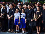 26 OCTOBER 2017 - BANGKOK, THAILAND:  People in line to leave sandalwood flower offerings for the late king during the funeral ceremony for Bhumibol Adulyadej, the Late King of Thailand. The king died on 13 October 2016 and was cremated 26 October 2017, after a mourning period of just over one year. The revered monarch was the longest reigning king in Thai history and is credited with guiding Thailand through the turbulent latter half of the 20th century.  PHOTO BY JACK KURTZ