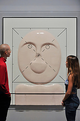 """© Licensed to London News Pictures. 17/10/2017. London, UK. Staff members view """"The Boy"""", 2000 at a preview of """"Not Everyone Will Be Taken Into The Future"""", the first UK exhibition by Russian artists Ilya and Emilia Kabakov.  The exhibition coincides with the 100th anniversary of the 1917 Russian Revolution and shows the couple's large scale installations and conceptual art.  Held at Tate Modern, the show runs 18 October to 28 January 2018. Photo credit : Stephen Chung/LNP"""