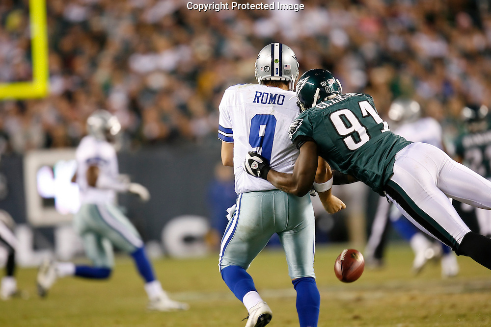 28 Dec 2008: Philadelphia Eagles defensive end Chris Clemons #91 knocks the ball from Dallas Cowboys quarterback Tony Romo #9 during the game against the Dallas Cowboys on December 28th, 2008. The Philadelphia Eagles won 44-6 at Lincoln Financial Field in Philadelphia, Pennsylvania.