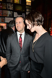 ADAM SHULMAN and actress ANNE HATHAWAY at a party to celebrate the launch of the Maison Assouline Flagship Store at 196a Piccadilly, London on 28th October 2014.  During the evening Valentino signed copies of his new book - At The Emperor's Table.