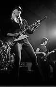 Edgar Winter on stage playing guitar