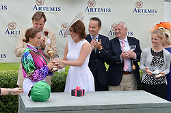 HRH PRINCESS EUGENIE OF YORK presents the Magnolia Cup to CAMILLA HENDERSON watched by THEO FENNELL at the Qatar Goodwood Festival - Ladies Day held at Goodwood Racecourse, West Sussex on 30th July 2015.
