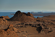 A cinder cone marks the harsh volcanic landscape of Bartolome island, one of the younger islands in the Galapagos Archipelago, Ecuador.