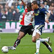 NLD/Rotterdam/20100919 - Voetbalwedstrijd Feyenoord - Ajax 2010, Georginio Wijnaldum in duel met Gregory van der Wiel