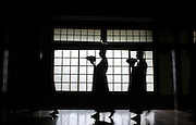 LIVING ZEN - HOSHINJI MONASTERY, OBAMA-JAPAN..Monks on the way for lunch. Each monk is using 3 bowls for the meals. They keep them in their rooms one inside the other and covered with a towel, until they lift them up to bring them at the table.