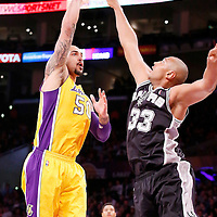 19 March 2014: Los Angeles Lakers center Robert Sacre (50) goes for the skyhook over San Antonio Spurs forward Boris Diaw (33) during the San Antonio Spurs 125-109 victory over the Los Angeles Lakers at the Staples Center, Los Angeles, California, USA.