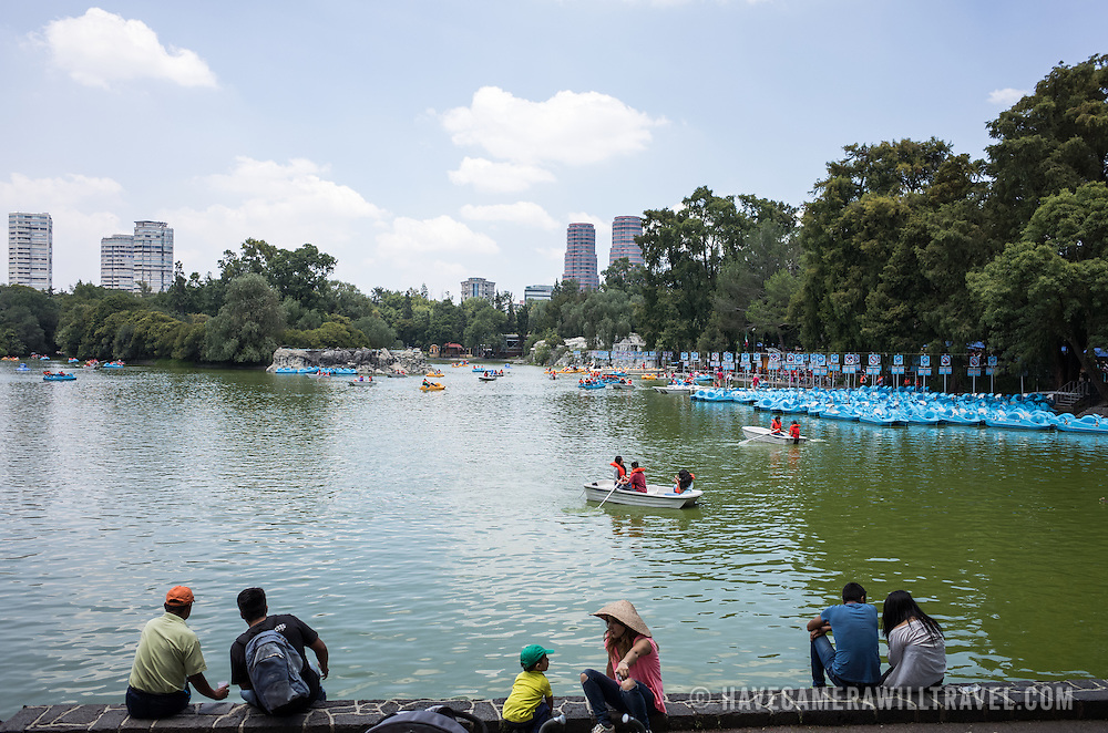 Paddle boats on the lake in Basque de Chapultepec, a large and popular public park in the center of Mexico City.