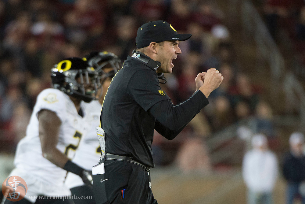 November 14, 2015; Stanford, CA, USA; Oregon Ducks head coach Mark Helfrich celebrates after a play during the third quarter against the Stanford Cardinal at Stanford Stadium. The Ducks defeated the Cardinal 38-36.