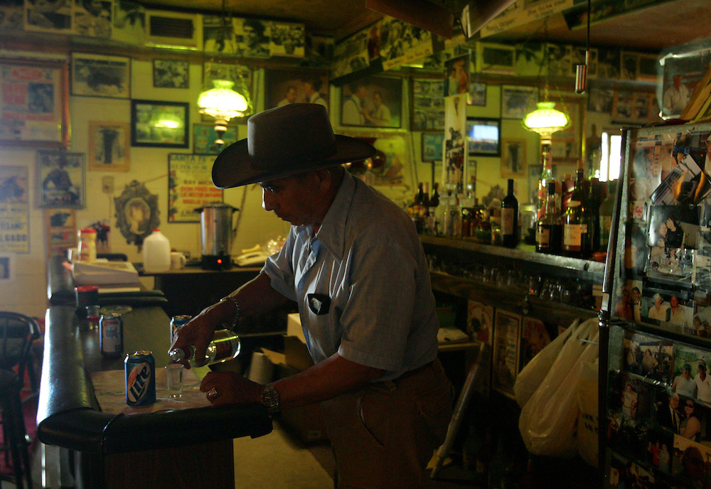 La Gloria, TX - 31 Aug 2008 <br /> Retired matador Jose Narciso Candelaria pours himself a shot of tequila before the start of Sunday's bloodless bullfight at the Santa Maria Bullring.