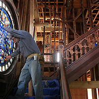 John Joy stabilizes an historic stained glass window for temporary removal os the 1890 Victorian home at the corner of Third Street and Leibrandt Avenue in Santa Cruz, California is remodeled into the Rio Vista boutique hotel. All of the stained glass windows and original woodwork will be reinstalled in the same spot.<br /> Photo by Shmuel Thaler <br /> shmuel_thaler@yahoo.com www.shmuelthaler.com