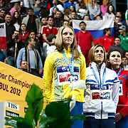 Silver medal winners Anna Chicherova from Russia (2ndR), Antonietta Di Martino from Italy (C) and Ebba Jungmark from Sweden (L), from right, listen to the anthem during the IAAF World Indoor Championships at the Atakoy Athletics Arena, Istanbul, Turkey. Photo by TURKPIX