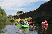 A kayak tour is led through the section of the Los Angeles River nicknamed the Little Grand Canyon by LA River Expeditions in one of the portions of the River opened as a Recreational Zone during the Summer months. Sepulveda Basin Recreation Area, Los Angeles, California, USA
