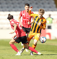 Hull City's Keane Lewis-Potter is tackled by Lincoln City's Jorge Grant<br /> <br /> Photographer Rich Linley/CameraSport<br /> <br /> The EFL Sky Bet League One - Lincoln City v Hull City - Saturday 24th April 2021 - LNER Stadium - Lincoln<br /> <br /> World Copyright © 2021 CameraSport. All rights reserved. 43 Linden Ave. Countesthorpe. Leicester. England. LE8 5PG - Tel: +44 (0) 116 277 4147 - admin@camerasport.com - www.camerasport.com