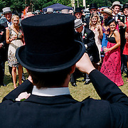 Spectators pose for a photograph on their arrive to The Royal Meeting Race meeting, Royal Ascot. England, UK. June 16-20th, 2009. Photo Tim Clayton