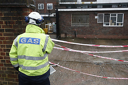 © Licensed to London News Pictures. 04/03/2018. Harold Hill, UK. A gas company worker look into the damaged back yard of Harold Hill Post Office where emergency services are currently responding to reports of an explosion. Nearby homes have been evacuated. Photo credit: Peter Macdiarmid/LNP