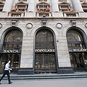 MILAN, ITALY - JUNE 07:  A city worker walk past the head office of Banca Popolare di Milano on June 7, 2010 in Milan, Italy. Today the Italian stock market suffered new losses in particular the banking sector and the Euro falls below $1.19, the lowest in over 4 years  (Photo by Marco Secchi/Getty Images)
