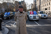 Mat of Mat 301, Black cab drivers demonstrating about Mayor Siddiq Khan comments and not being allowed into bus lanes, Parliament Sq. , London. 11 March 2019