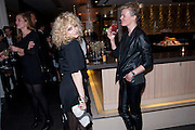 ALISON GOLDFRAPP; LISA GUNNING;;, Esquire dinner celebrating being Brilliant, Young and British hosted by editor Jeremy Langmead at Aqua Nueva, Fifth Floor, 240 Regent Street , London 1 June 2010. -DO NOT ARCHIVE-© Copyright Photograph by Dafydd Jones. 248 Clapham Rd. London SW9 0PZ. Tel 0207 820 0771. www.dafjones.com.