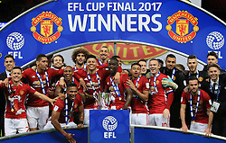 26 February 2017 - EFL Cup Final - Manchester United v Southampton - Manchester United players celebrate with the trophy - Photo: Marc Atkins / Offside.