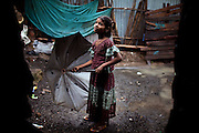 Poonam, 9, is standing in the front-yard of her newly built home in Oriya Basti, one of the water-affected colonies in Bhopal, Madhya Pradesh, India, near the abandoned Union Carbide (now DOW Chemical) industrial complex.