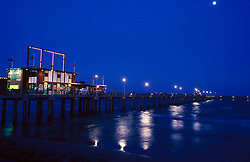 Stock photo of a pier with a retail store going over Galveston Bay