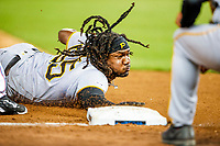 Josh Bell dives in head first after hitting a triple during  a game between the Pittsburgh Pirates and the Miami Marlins at Marlins Park in Miami.<br /> ( Photo/Tom DiPace)