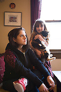Margaret B. Jones with her daughter, Rya Hickey, in the living room of their Eugene, Oregon home.