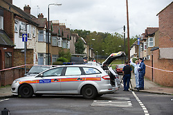 ©London News pictures...  24/10/2010. File picture dated 23/10/2010. Police and forensics at Chesterton Road, Plaistow, East London yesterday morning (Sat) where a 16 year-old boy was shot dead. A second teenager, thought to be 15, was taken to an east London hospital where his condition is understood to be critical.