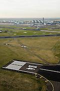 Nederland, Haarlemmermeer, Schiphol, 15-02-2007;  Schiphol airport, zicht op stationsgebouw (terminal) van de luchthaven met verkeerstoren, verschillend start- en landingsbanen: de 04 in de voorgrond (Schiphol Oostbaan), midden in beeld de Aalsmeerbaan, daarachter - met KLM vliegtuigen: de Kaagbaan; slot, geluidsoverlast, profiel, geluidscontour, hinderwet, vliegen, toerisme, verkeersleiding, infrastuctuur, verkeer en vervoer, start, landing.luchtfoto (toeslag); aerial photo (additional fee required); .foto Siebe Swart / photo Siebe Swart