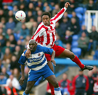 Photo: Scott Heavey.<br />Reading v Stoke City. Nationwide Division One. 13/03/2004.<br />Wayne Thomas of Stoke climbs all over Shaun Goater (L)