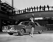 Y-661005-12.  Lloyd Center, Chrysler auto show. Advance publicity photos. Dianne Schatz, professional ice skater. October 5, 1966 Portland, Oregon