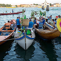 VENICE, ITALY - JULY 19:  Boats and party goers gather in St Mark's Basin and Giudecca Canal on the day of the Redentore Celebration on July 19, 2014 in Venice, Italy. Redentore , which is in remembrance of the end of the 1577 plague, is one of Venice's most loved celebrations. Highlights of the celebration include the pontoon bridge extending across the Giudecca Canal, gatherings on boats in the St. Mark's Basin and a spectacular fireworks display.  (Photo by Marco Secchi/Getty Images)