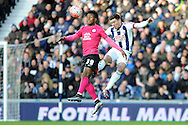 West Brom's Sebastien Pocognoci (r) beats Peterborough's Shaquile Coulthirst to a header. The Emirates FA Cup, 4th round match, West Bromwich Albion v Peterborough Utd at the Hawthorns stadium in West Bromwich, Midlands on Saturday 30th January 2016. pic by Carl Robertson, Andrew Orchard sports photography.