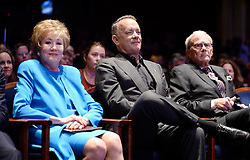 """Actor and Campaign Chair Tom Hanks (C) , Elizabeth Dole Foundation Founder and President Elizabeth Dole (L) and journalist Tom Brokaw, (R) attend the launch of """"Hidden Heroes"""" campaign at the Capitol September 27, 2016 in Washington, DC. The Hidden Heroes campaign has been created to generate stronger support for America's 5.5 million military and veteran caregivers. Photo by Olivier Douliery/Abaca"""