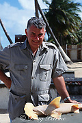 Shark scientist Dr. Jose Castro with specimen of golden hammerhead, or smalleye hammerhead shark, Sphyrna tudes, Trinidad, West Indies ( Caribbean Sea )