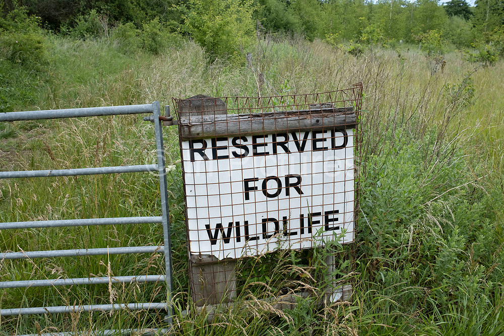 Reserved for wildlife sign at the edge of a wildlife reserve on 20th June 2020 in Studley, United Kingdom. A nature reserve, also known as a natural reserve, wildlife refuge, wildlife sanctuary, biosphere reserve or bioreserve, natural or nature preserve, or nature conservation area, is a protected area of importance for flora, fauna, or features of geological or other special interest, which is reserved and managed for purposes of conservation and to provide special opportunities for study or research.