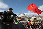 MLKP Marxist-Leninist Communist Party red flags during May Day celebrations in London, England, United Kingdom. Demonstration by unions and other organisations of workers to mark the annual May Day or Labour Day. Groups from all nationalities from around the World, living in London gathered to march to a rally in central London to mark the global workers day.