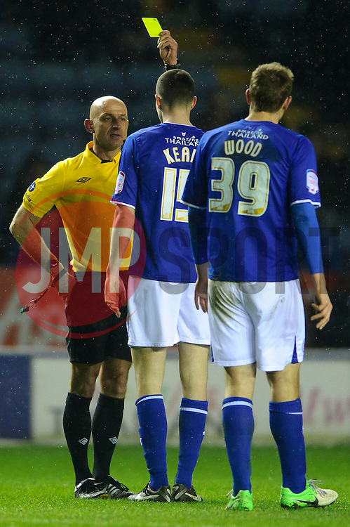 Leicester Defender Michael Keane (ENG) is shown a yellow card by referee Roger East for a hand ball during the second half of the match - Photo mandatory by-line: Rogan Thomson/JMP - Tel: Mobile: 07966 386802 18/01/2013 - SPORT - FOOTBALL - King Power Stadium - Leicester. Leicester City v Middlesbrough - npower Championship.