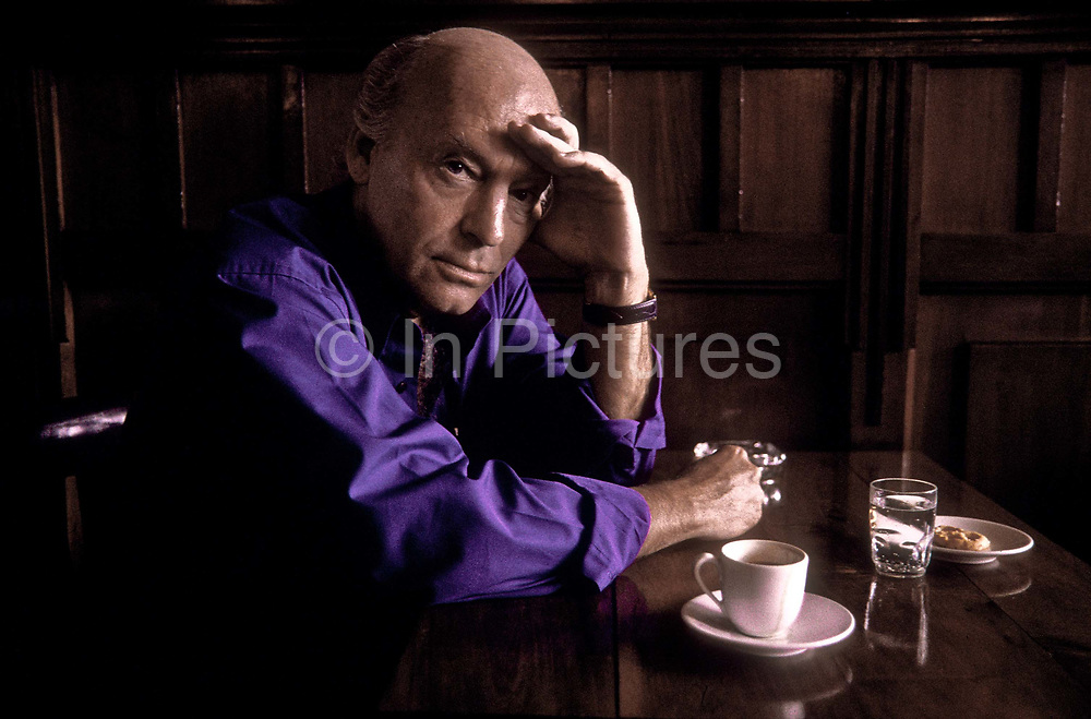 """Reknown author Eduardo Galeano in a Montevideo café, Uruguay.  (born September 3, 1940) is a Uruguayan journalist, writer and novelist. His most well known works are Memoria del fuego (Memory of Fire, 1986) and Las venas abiertas de América Latina (Open Veins of Latin America, 1971) which have since been translated into twenty languages and transcend orthodox genres: combining fiction, journalism, political analysis, and history. The author himself has denied that he is a historian saying, """"I'm a writer obsessed with remembering, with remembering the past of America above all and above all that of Latin America, intimate land condemned to amnesia."""""""