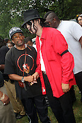 l to r: Spike Lee and Michael Jacskon Impersonator at the Spike Lee's Brooklyn celebration for Michael Jackson's Birthday held at the Neader field in Prospect Park, Brooklyn on August 29, 2009..Filmmaker Spike Lee celebrates the ' King of Pop ' Birthday with a crowd packed party remembering the recently departing All time Great with a day long spinning of his music in Brooklyn's own Prospect Park